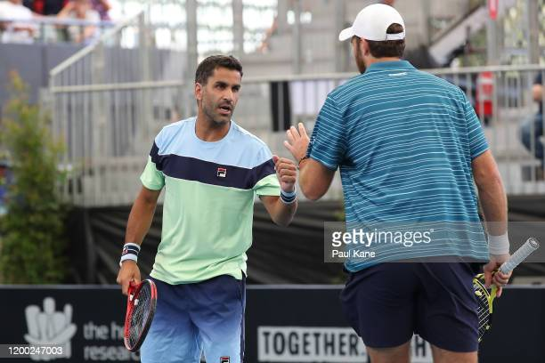 Maximo Gonzalez of Argentina and Fabrice Martin of France celebrate a point during the men's doubles grand final against Ivan Dodig of Croatia and...