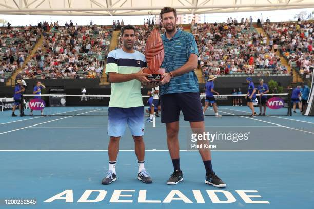 Maximo Gonzalez of Argentina and Fabrice Martin of France pose with the trophy after winning the men's doubles grand final against Ivan Dodig of...