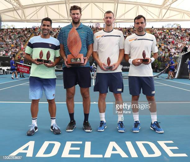 Maximo Gonzalez of Argentina and Fabrice Martin of France pose with Ivan Dodig of Croatia and Filip Polasek of Slovakia following the men's doubles...