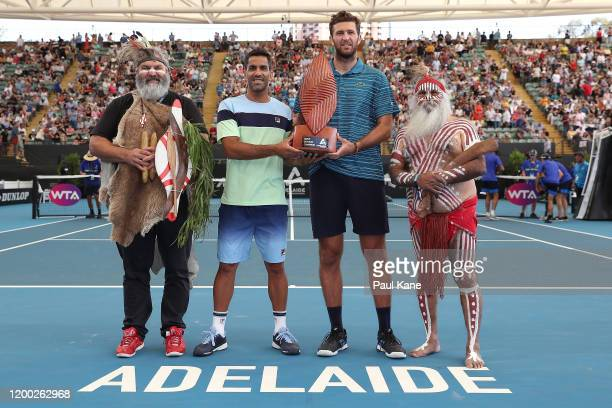 Maximo Gonzalez of Argentina and Fabrice Martin of France pose with the trophy together with Aboriginal elders Mickey Kumatpi O'Brien and Major...