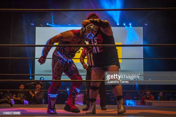Maximo moves to take off the mask of Aerostar as during an AAA World Wide Wrestling match on November 16 2018 in Bogota Colombia