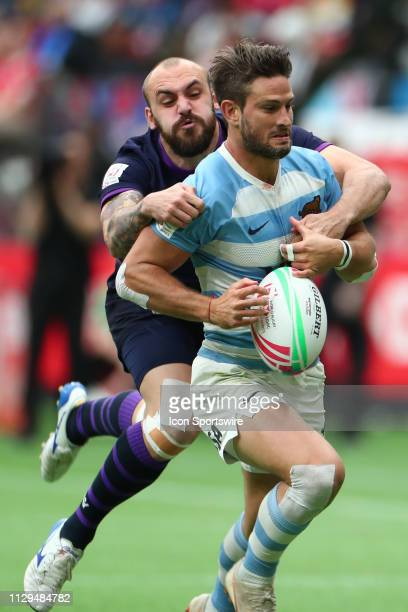 Maximo Provenzano of Argentina runs the ball and attempts to avoid the tackle of Sam Pecqueur of Scotland during day 1 of the 2019 Canada Sevens...