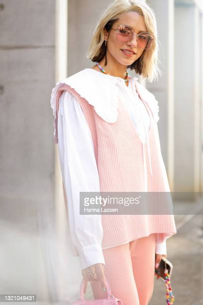 Maxine Wylde wearing Blanca Studio shirt, Frankie Shop vest, Onarins pants, Gucci shoes and sunglasses and Balenciaga pink leather bag at Afterpay...