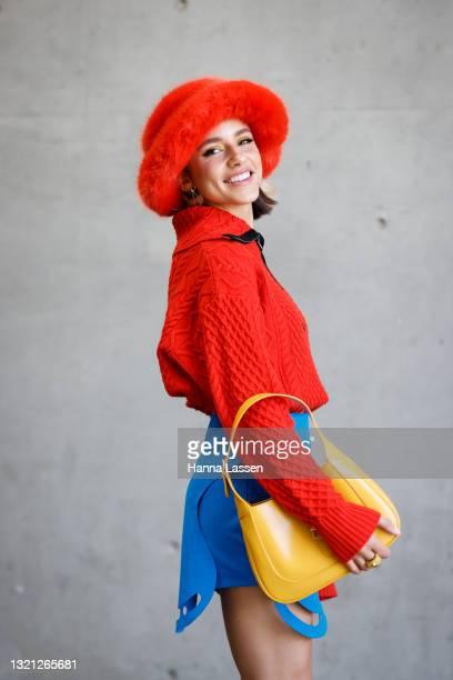 Maxine Wylde wearing Jumper Wynn Hamlyn, Skirt Tyler Mcgillivary, Shoes Nodaleto, Hat Emma Brewin, Bag Gucci and Earrings Mountain and Moo at...
