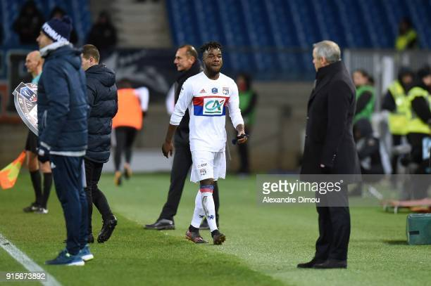 Maxwel Cornet and Bruno Genesio Coach of Lyon during the French Cup match between Montpellier and Lyon at Stade de la Mosson on February 7 2018 in...