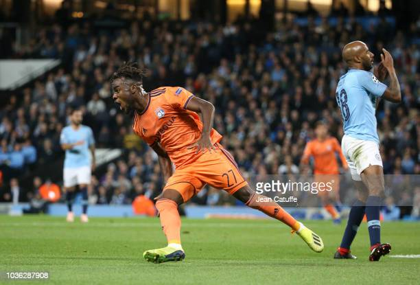 Maxwel Cornet of Lyon celebrates his goal while Fabian Delph of Manchester City is dejected during the Group F match of the UEFA Champions League...