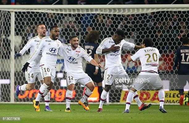 Maxwel Cornet of Lyon celebrates his goal with teammates Sergi Darder Alexandre Lacazette Jordan Ferri Rafael da Silva of Lyon during the French...