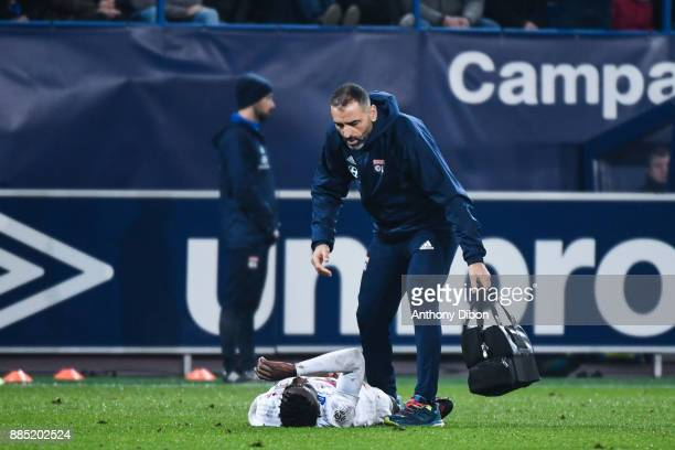 Maxwel Cornet of Lyon leave the pitch injured during the Ligue 1 match between SM Caen and Olympique Lyonnais at Stade Michel D'Ornano on December 3...
