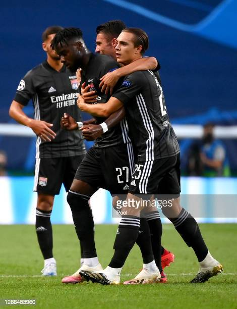 Maxwel Cornet of Olympique Lyon celebrates with teammates after scoring his team's first goal during the UEFA Champions League Quarter Final match...