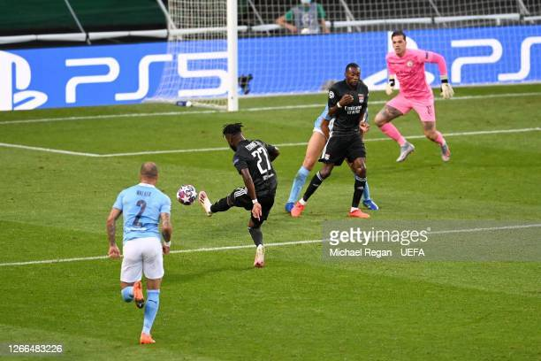 Maxwel Cornet of Olympique Lyon scores his team's first goal during the UEFA Champions League Quarter Final match between Manchester City and Lyon at...