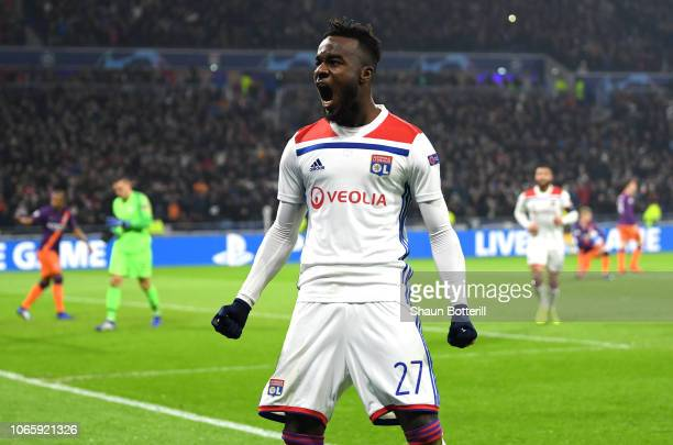 Maxwel Cornet of Olympique Lyonnais celebrates as he scores his team's first goal during the UEFA Champions League Group F match between Olympique...