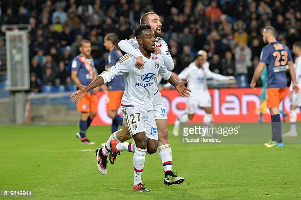 Maxwel Gnaly Cornet of Lyon celebrates after scoring the first goal during the Ligue 1 match between Montpellier Herault SC and Olympique Lyonnais at...