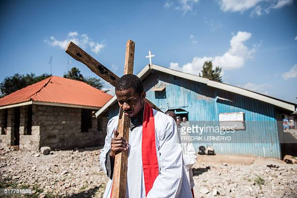 Maxwell a deacon of the Legio Maria African Mission church leads a procession marking Good friday in Nairobi on March 25 2016 Legio Maria Latin for...