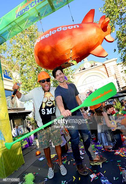 Maxwell and actor Josh Peck break the giant pinata for raffle winners during Nickelodeon's 2015 Kids' Choice Awards pinata tickets giveaway at The...