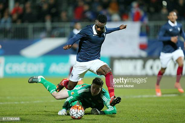 Maxwell Cornet of France and Jack Hamilton of Scotland during the Uefa U21 European Championship qualifier between France and Scotland at Stade Jean...