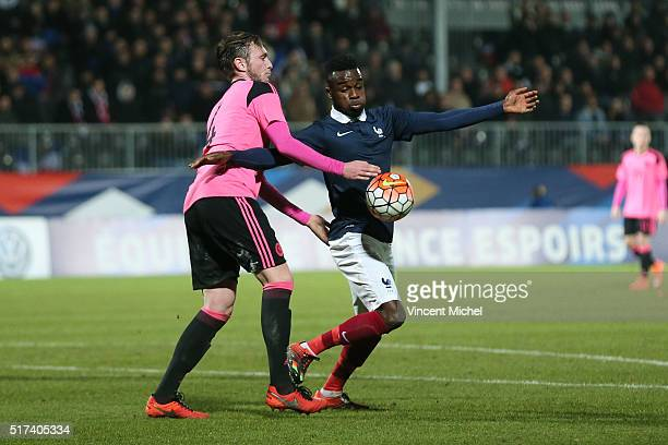 Maxwell Cornet of France and Jordan McGhee of Scotland during the Uefa U21 European Championship qualifier between France and Scotland at Stade Jean...