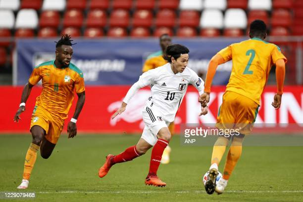Maxwell Cornet of Ivory Coast, Takumi Minamino of Japan, Sinaly Diomande or Ivory Coast during the friendly match between Japan and Ivory Coast at...