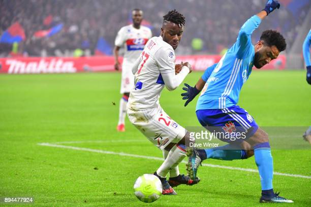Maxwell Cornet of Lyon and Jordan Amavi of Marseille during the Ligue 1 match between Olympique Lyonnais and Olympique Marseille at Parc Olympique on...