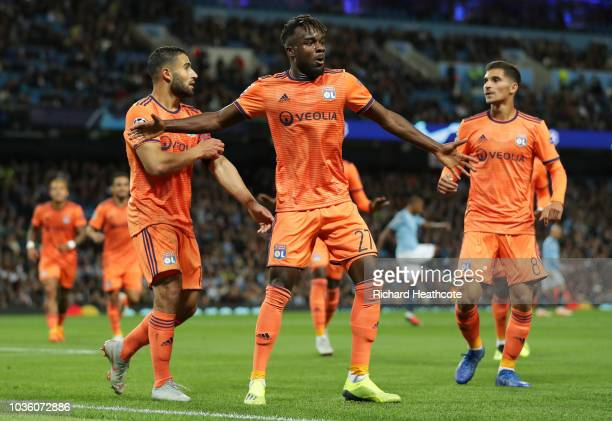 Maxwell Cornet of Lyon celebrates after scoring his team's first goal with his team mates during the Group F match of the UEFA Champions League...
