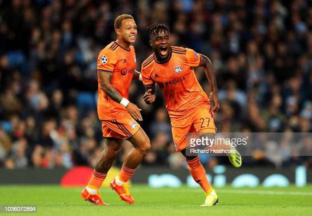 Maxwell Cornet of Lyon celebrates after scoring his team's first goal with Memphis Depay of Lyon during the Group F match of the UEFA Champions...