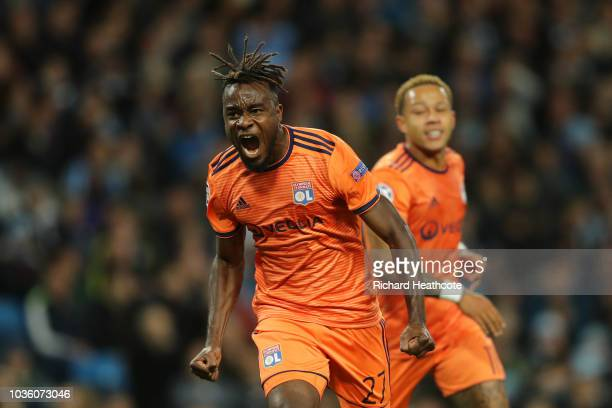 Maxwell Cornet of Lyon celebrates after scoring his team's first goal during the Group F match of the UEFA Champions League between Manchester City...