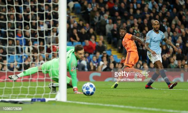 Maxwell Cornet of Lyon scores his team's first goal past Ederson of Manchester City during the Group F match of the UEFA Champions League between...