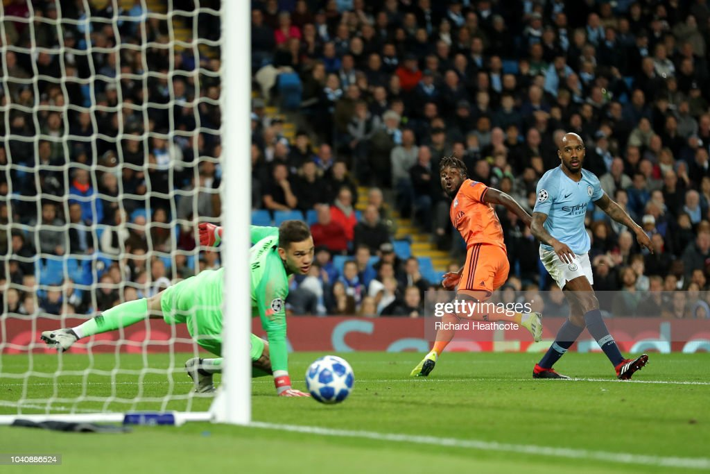 Maxwell Cornet of Lyon scores his team's first goal past Ederson of Manchester City after a mistake by Fabian Delph during the Group F match of the UEFA Champions League between Manchester City and Olympique Lyonnais at Etihad Stadium on September 19, 2018 in Manchester, United Kingdom.