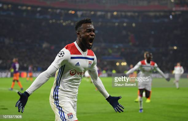 Maxwell Cornet of Olympique Lyonnais celebrates after scoring the second goal during the UEFA Champions League Group F match between Olympique...