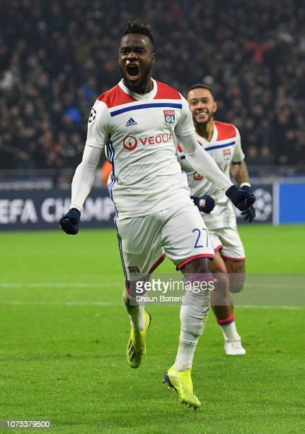 Maxwell Cornet of Olympique Lyonnais celebrates after scoring the first goal during the UEFA Champions League Group F match between Olympique...