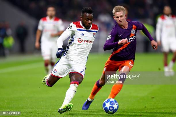 Maxwell Cornet of Olympique Lyonnais is challenged by Oleksandr Zinchenko of Manchester City during the Group F match of the UEFA Champions League...