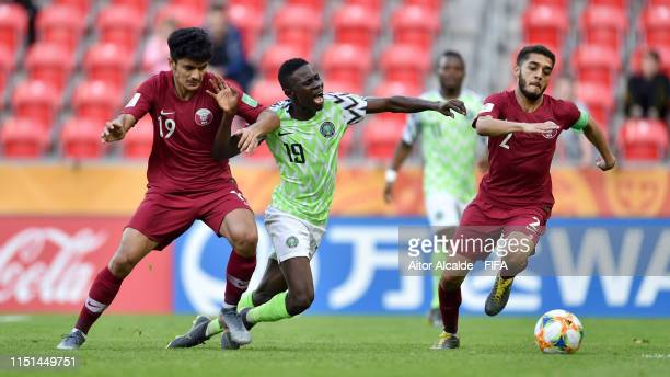 Maxwell Effiom of Nigeria is brought down by Ahmed Suhail of Qatar during the 2019 FIFA U-20 World Cup group D match between Qatar and Nigeria at...