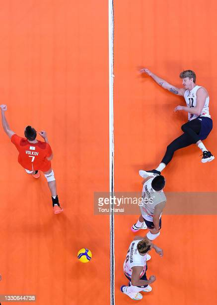 Maxwell Holt of Team United States and Dmitry Volkov of Team ROC battle at the net during the Men's Preliminary Round - Pool B volleyball on day...