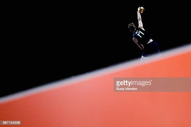 Maxwell Holt of the United States spikes the ball during the Men's Preliminary Pool A match between the United States and Canada on Day 2 of the Rio...
