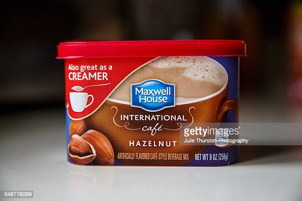 Maxwell House International instant hazelnut coffee in a small package with lid. Prepared coffee mix that can be used as a flavored drink creamer.