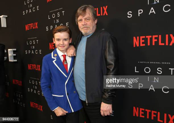 Maxwell Jenkins and Mark Hamill attend Netflix's 'Lost In Space' Los Angeles premiere on April 9 2018 in Los Angeles California
