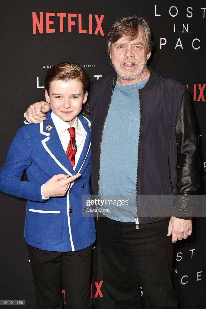 Maxwell Jenkins and Mark Hamill attend the 'Lost In Space' Season 1 Premiere at ArcLight Cinerama Dome on April 9, 2018 in Hollywood, California.