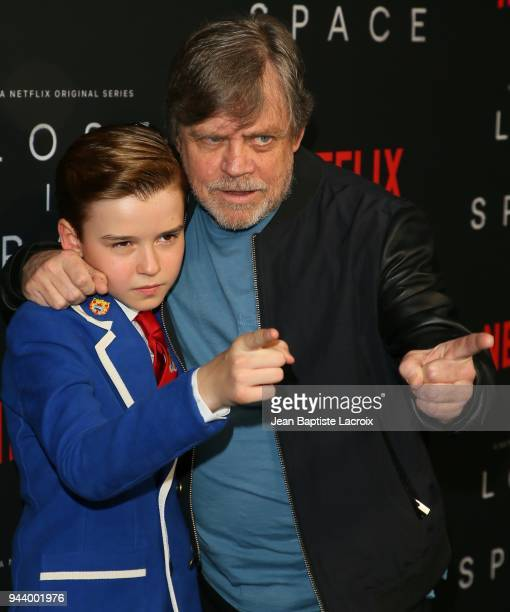 Maxwell Jenkins and Mark Hamill attend the premiere of Netflix's 'Lost In Space' Season 1 on April 9 2018 in Los Angeles California