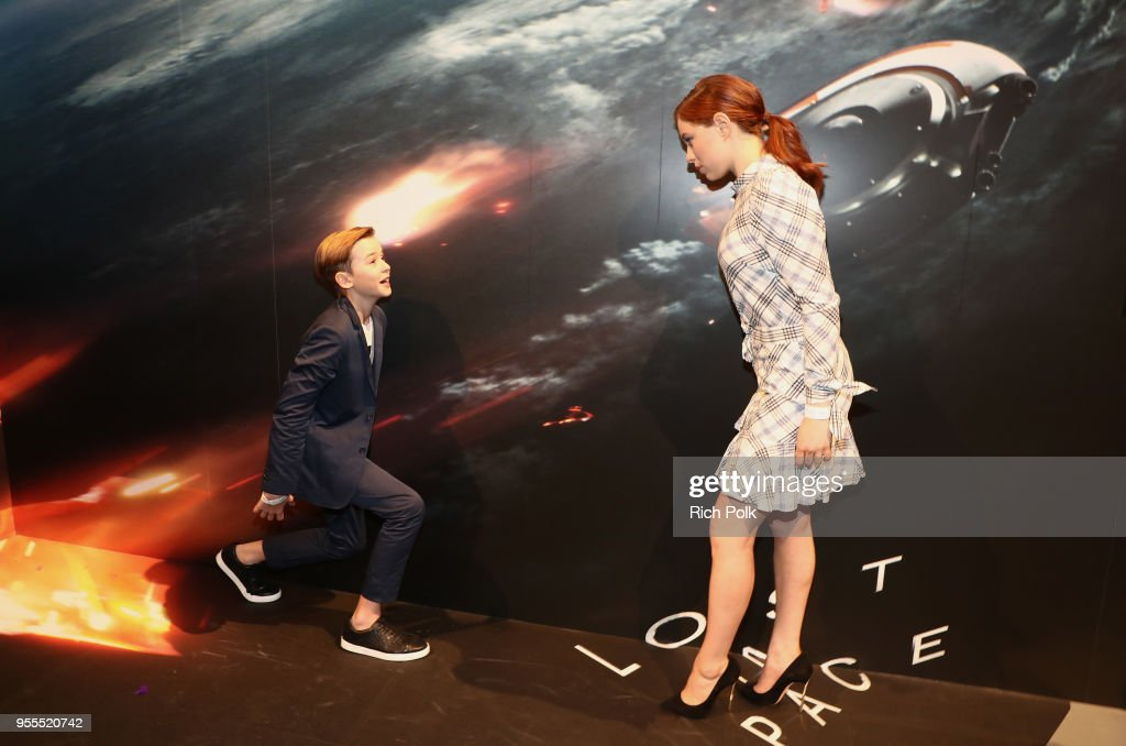 Maxwell Jenkins (L) and Mina Sundwall attend the Netflix FYSee Kick Off Party at Raleigh Studios on May 6, 2018 in Los Angeles, California.