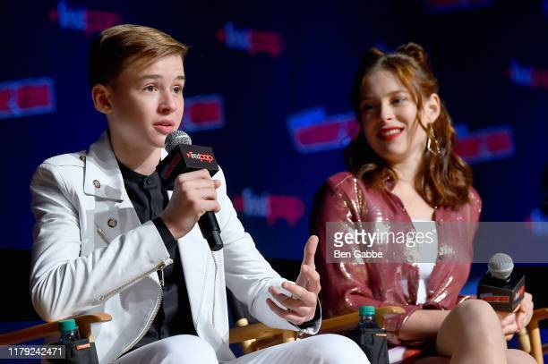 Maxwell Jenkins and Mina Sundwall onstage during the Netflix Presents Lost in Space panel at New York Comic Con 2019 Day 3 at Jacob K Javits...