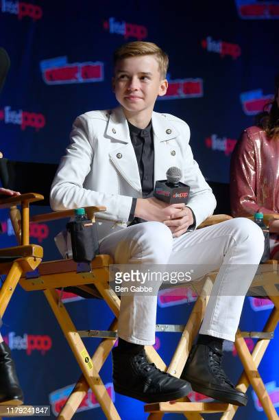 Maxwell Jenkins speaks during the Netflix Presents Lost in Space panel at New York Comic Con 2019 Day 3 at Jacob K Javits Convention Center on...