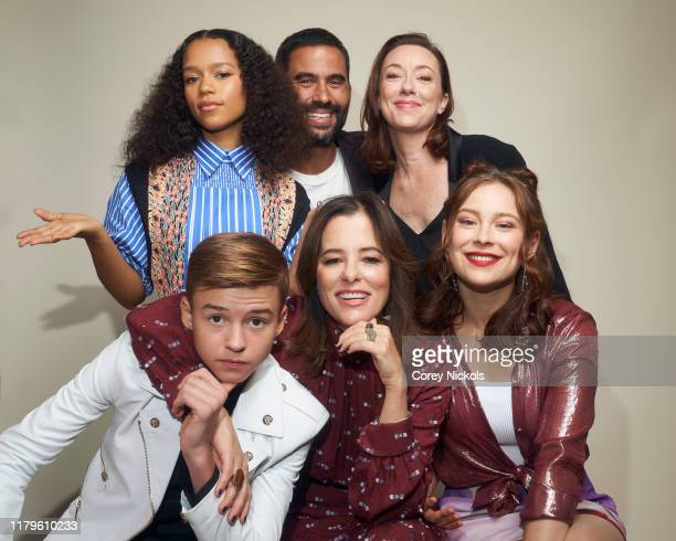 """Maxwell Jenkins, Taylor Russell, Ignacio Serricchio, Parker Posey, Molly Parker and Mina Sundwall of """"Lost In Space"""" poses for a portrait during 2019..."""