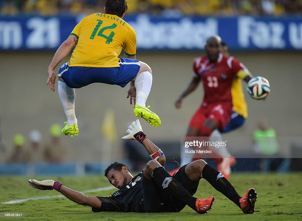 Maxwell (#14) of Brazil and Goalkeeper Oscar McFarlane of Panama compete for the ball during the International Friendly Match between Brazil and Panama at Serra Dourada Stadium on June 03, 2014 in Goiania, Brazil.