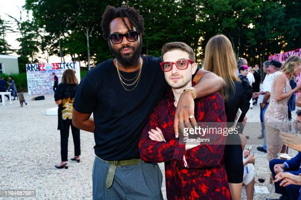 Maxwell Osborne and Alex Soros attend Tabula Rasa The 26th annual Watermill Center Benefit Auction at The Watermill Center on July 27 2019 in Water...