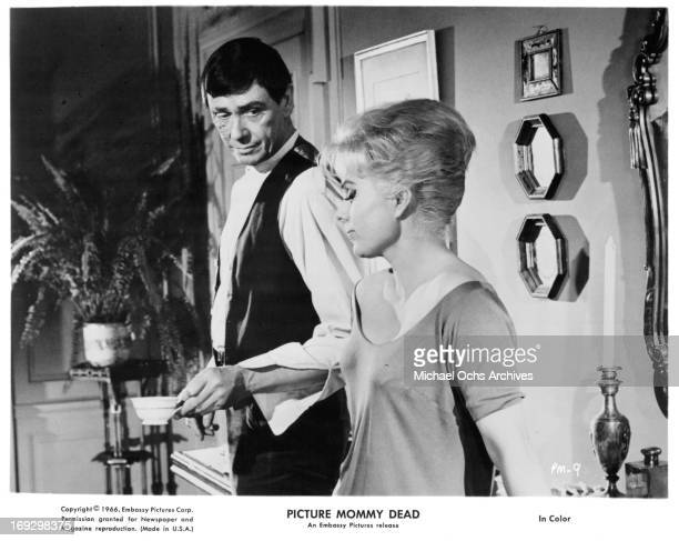 Maxwell Reed has tea with Martha Hyer in a scene from the film 'Picture Mommy Dead' 1966