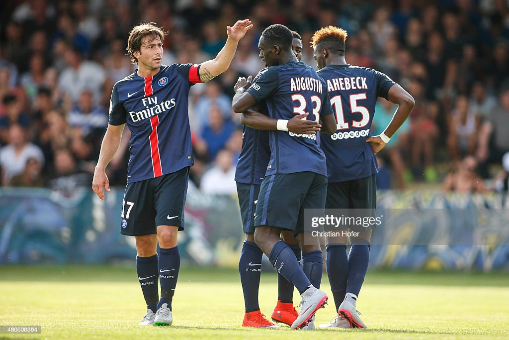 Maxwell Scherrer Cabelino Andrade, Jean-Kevin Augustin and Jean-Christophe Bahebeck of Paris Saint-Germain celebrate after scoring during the Friendly Match between Wiener Sportklub and Paris Saint-Germain at Sportclub Platz on July 12, 2015 in Vienna, Austria.