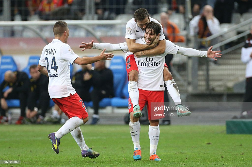 Maxwell Scherrer of PSG celebrates his goal with Yohan Cabaye and Marco Verratti of PSG during the French Ligue 1 match between RC Lens and Paris Saint-Germain FC at Stade de France on October 17, 2014 in Saint-Denis near Paris, France.