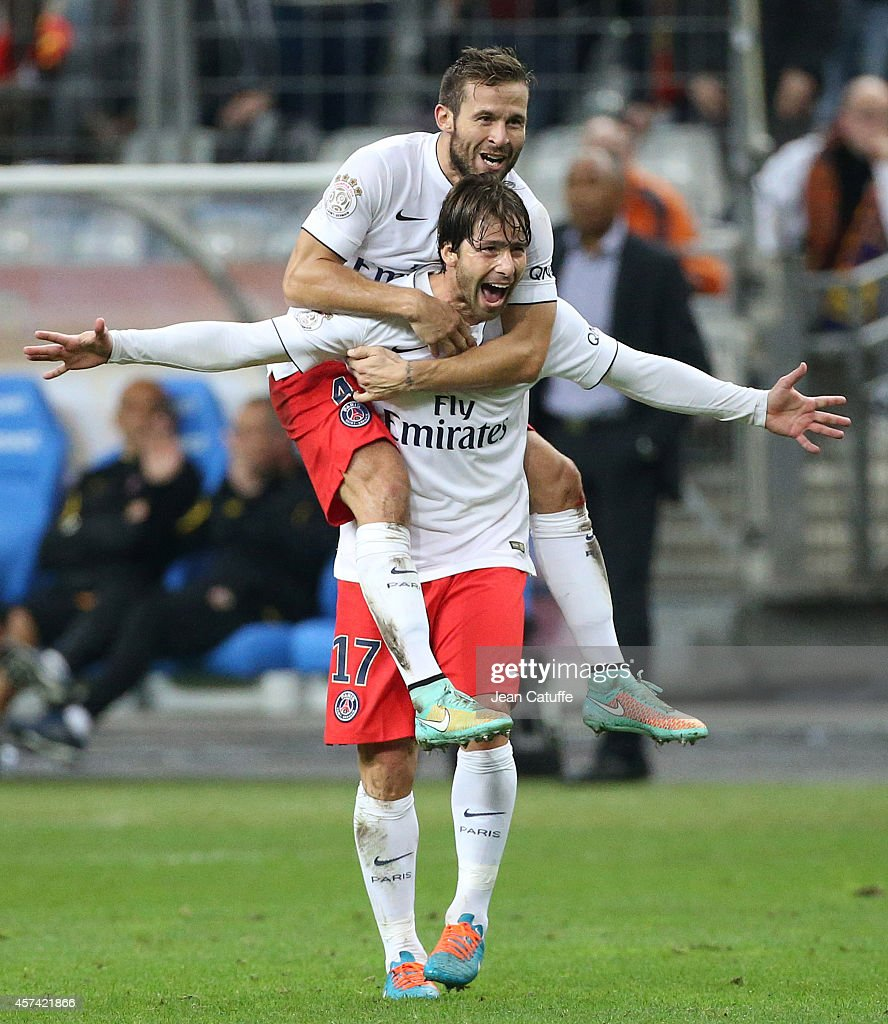 Maxwell Scherrer of PSG celebrates his goal with Yohan Cabaye of PSG during the French Ligue 1 match between RC Lens and Paris Saint-Germain FC at Stade de France on October 17, 2014 in Saint-Denis near Paris, France.