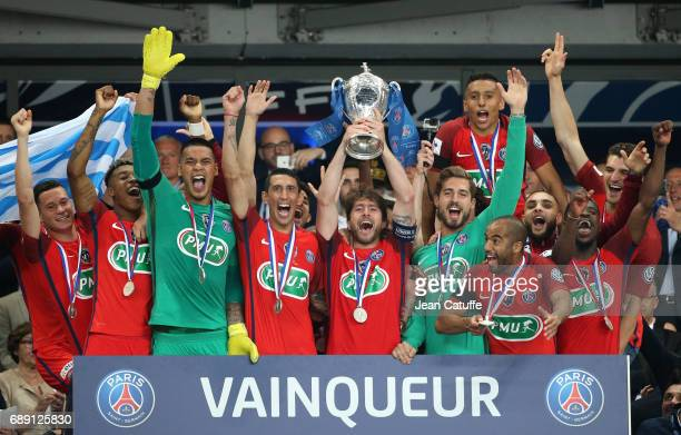 Maxwell Scherrer of PSG holds the trophy and celebrate with teammates winning the French Cup final between Paris SaintGermain and SCO Angers at Stade...