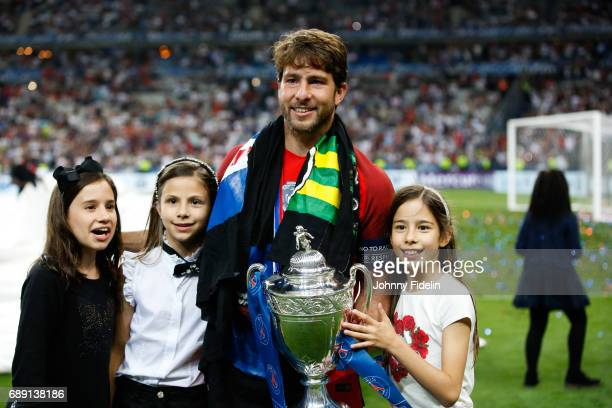 Maxwell Sherrer of Paris Saint Germain with the trophy and his children after winning the National Cup Final match between Angers SCO and Paris Saint...