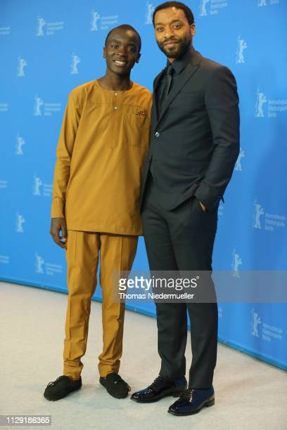 Maxwell Simba and director Chiwetel Ejiofor pose at the photocall for the Netflix film The Boy Who Harnessed The Wind during the 69th Berlinale...